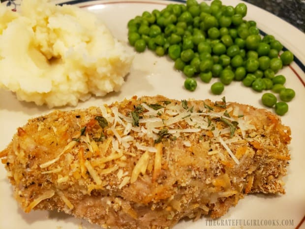 One of the easy baked pork chops, served with mashed potatoes and peas.