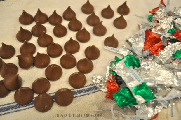 Unwrapped Hershey Kisses, ready to add to baked cookies.