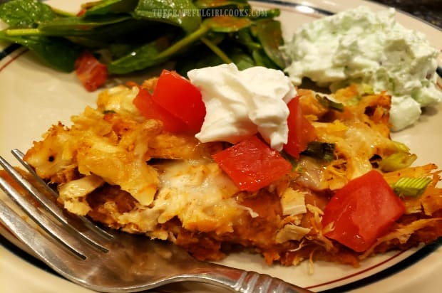A dollop of sour cream garnishes this serving of turkey fiesta casserole.