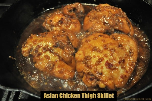 Asian Chicken Thigh Skillet is a delicious, EASY dish to make. Chicken thighs are pan-seared, then covered and cooked in a simple Asian garlic sauce!