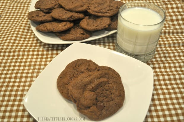 A glass of cold milk is served with the mocha chocolate chip cookies.