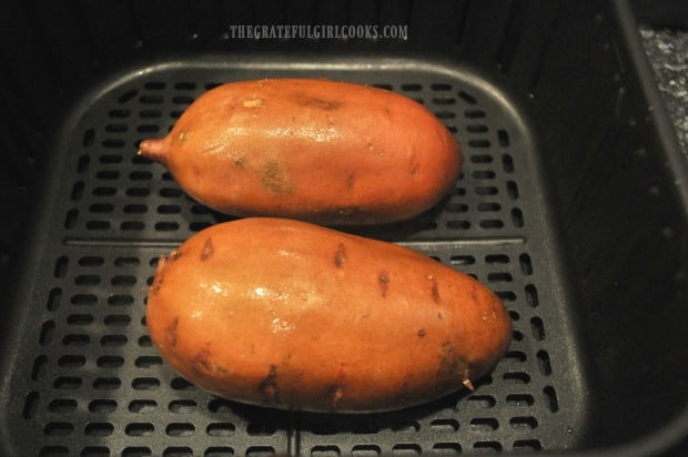 Each sweet potato is rubbed or spritzed with oil lightly, before cooking.