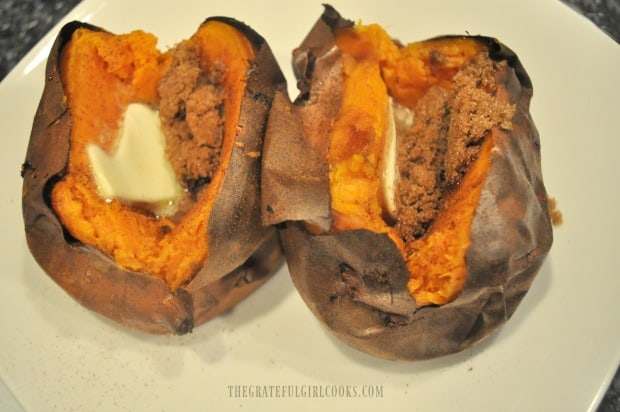 Two of the air fryer sweet potatoes, filled with butter, cinnamon and brown sugar.