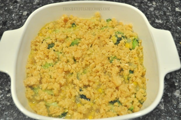 Buttery crumb topping is added to top of broccoli corn casserole before cooking.