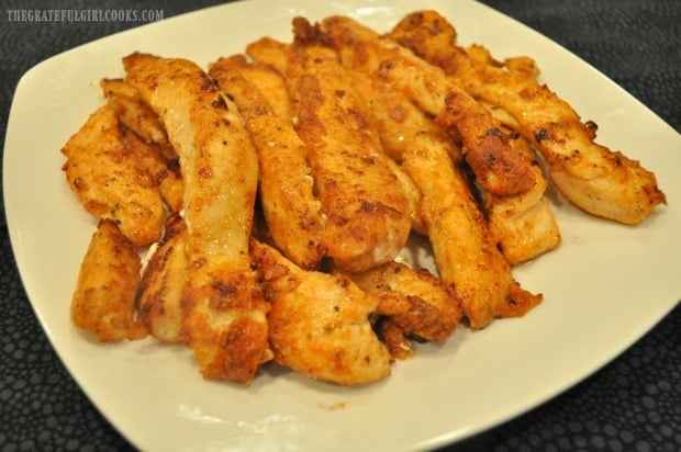 A plate full of cajun chicken strips, cooked and ready to eat!