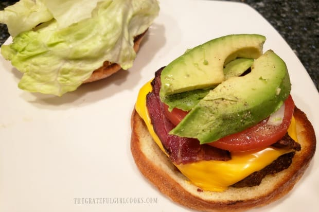 Air fryer bacon cheeseburger is assembled before eating.