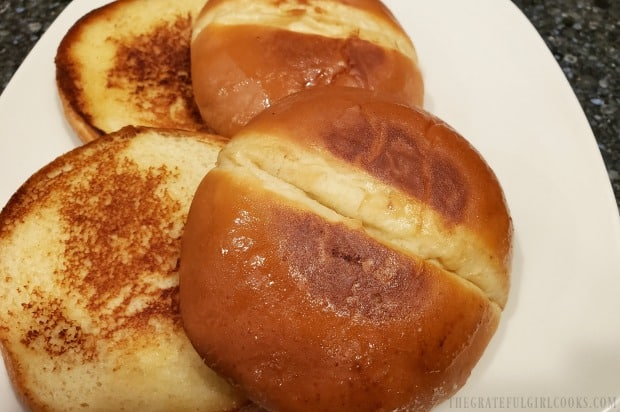 Hamburger buns, after being lightly toasted with butter in a skillet