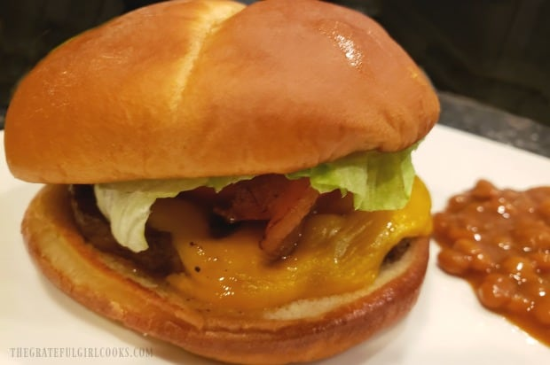A juicy, hot air fryer bacon cheeseburger, ready to devour.