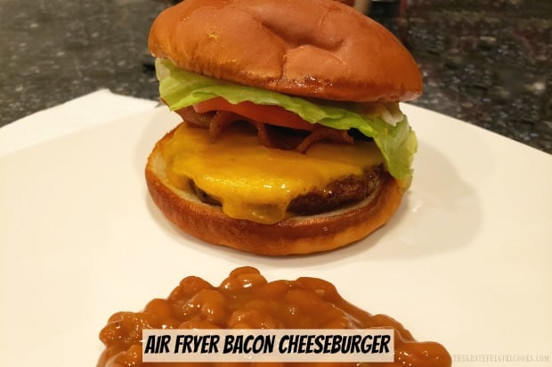 Learn how easy it is to make a juicy good Air Fryer Bacon Cheeseburger, using this appliance. Can't get outside to grill? Use an air fryer instead!