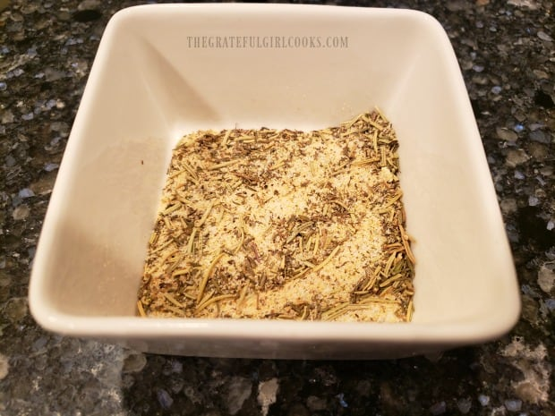 A dry spice mix is made to season chicken thighs.