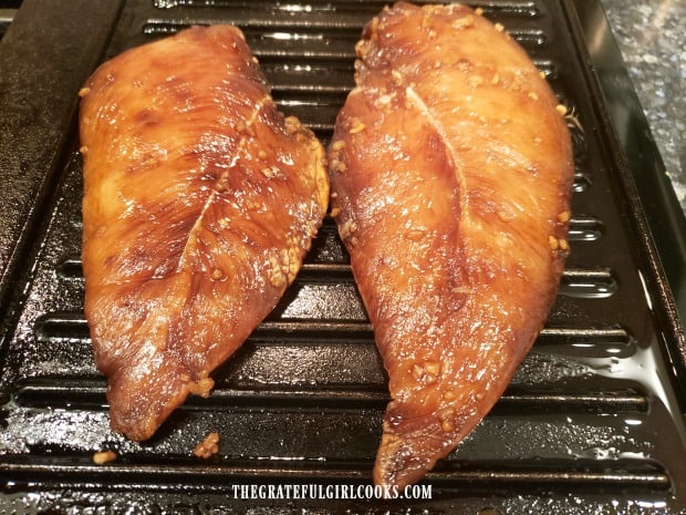 Marinated chicken breasts are grilled for the sandwich.