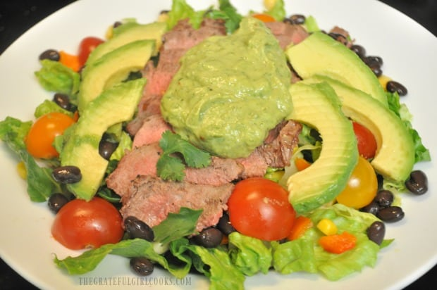 Dollop a steak salad with avocado cilantro lime dressing to finish.