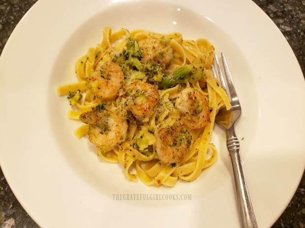 A serving dish of herbed shrimp broccoli pasta, ready to enjoy!
