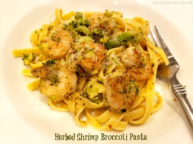 Herbed Shrimp Broccoli Pasta is a delicious, Italian-inspired meal of pan-seared shrimp, broccoli, and pasta noodles w/ Parmesan, olive oil & spices.