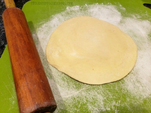 "The biscuit dough is rolled out into a 6"" circle for the pizza pan."
