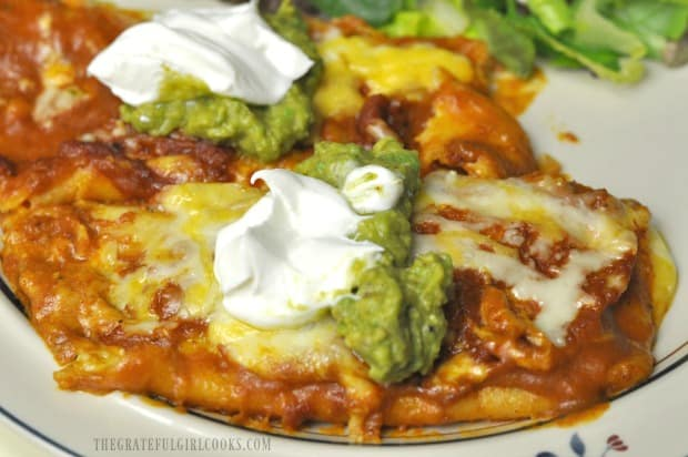 Fresh guacamole and sour cream are another garnish for the baked cheese enchiladas.