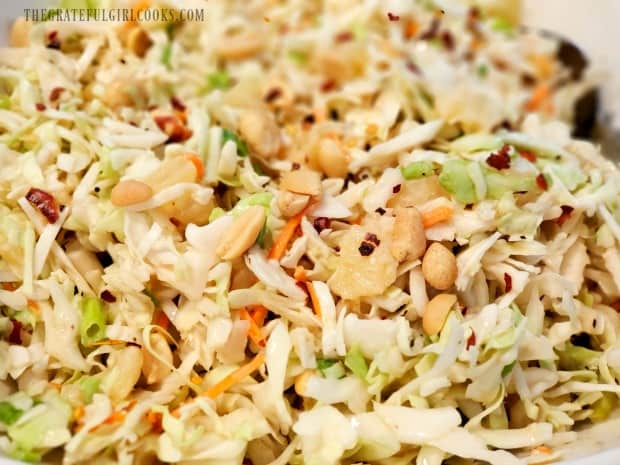 Peanuts and red pepper flakes garnish the chilled coleslaw.