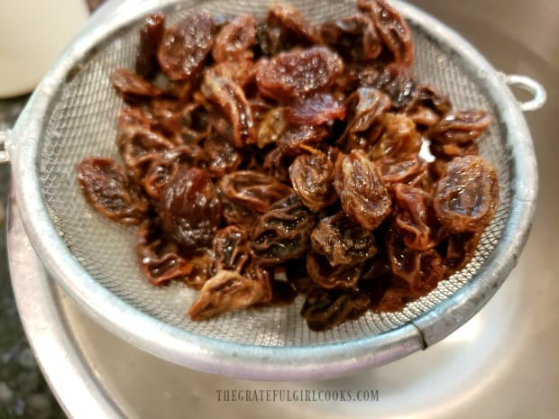 The raisins are drained after being plumped up in boiling hot water.