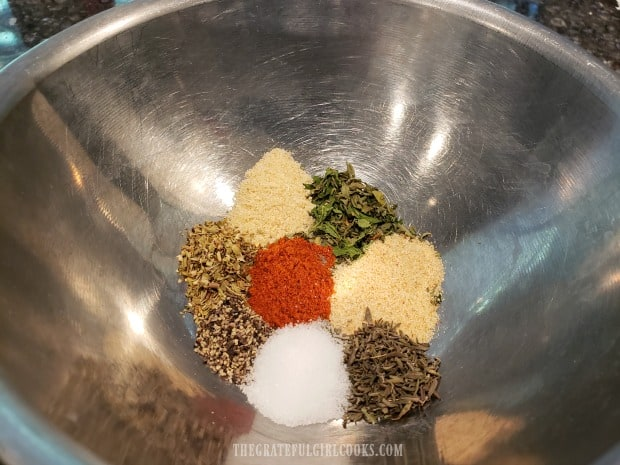 Spices for the black beans and rice are combined in a small bowl.