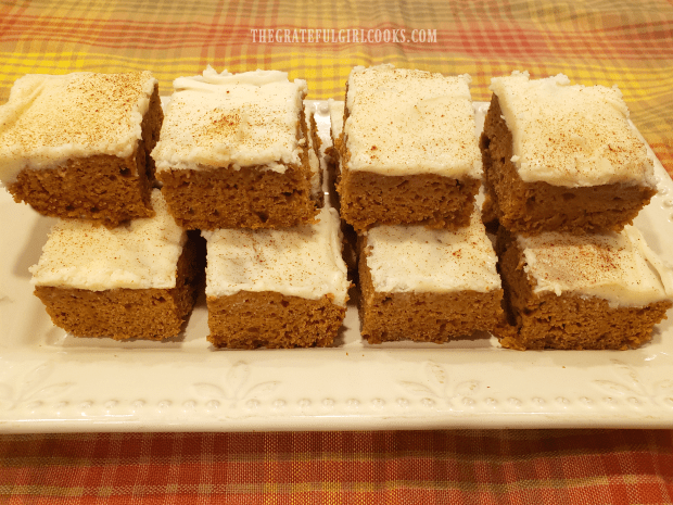 Long platter of stacked, frosted pumpkin bars, ready to enjoy!