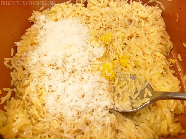 Finely grated Parmesan cheese, lemon zest, juice and pepper are added to cooked orzo.