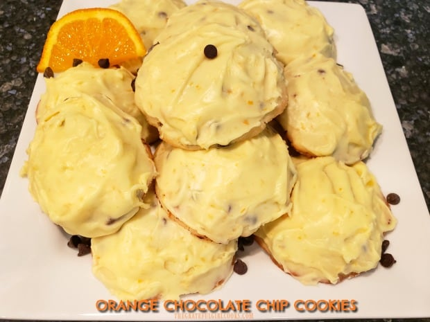 Orange Chocolate Chip Cookies, topped with a creamy orange frosting, are a soft, delicious, and wonderfully decadent treat you will enjoy!