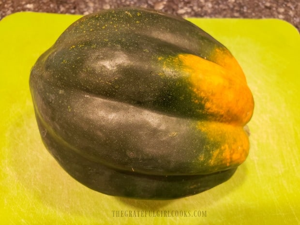 A whole acorn squash, before de-seeding and slicing.