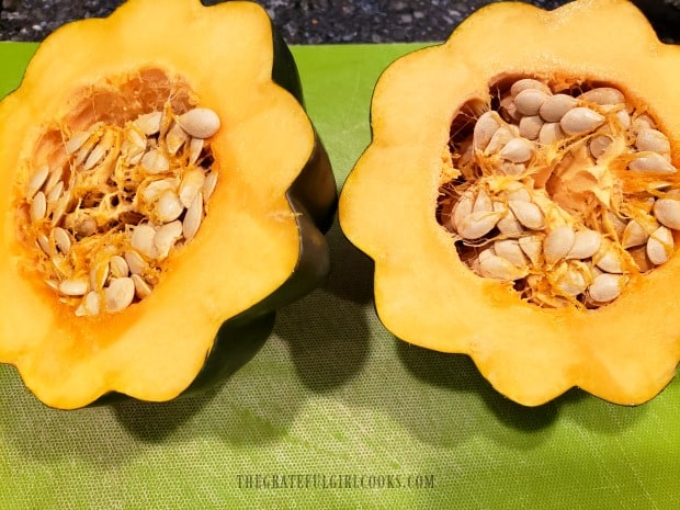 After slicing the squash in half, the seeds need to be removed.