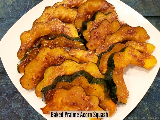 Baked Praline Acorn Squash is a delicious side dish! Crescent-shaped slices, topped w/ caramelized brown sugar, pecans, maple syrup & spices!