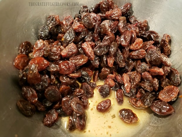 Raisins are soaked in rum before adding to muffin batter.