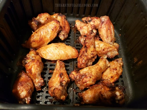 Air Fryer Buffalo Honey Wings in the basket halfway though the cooking time.