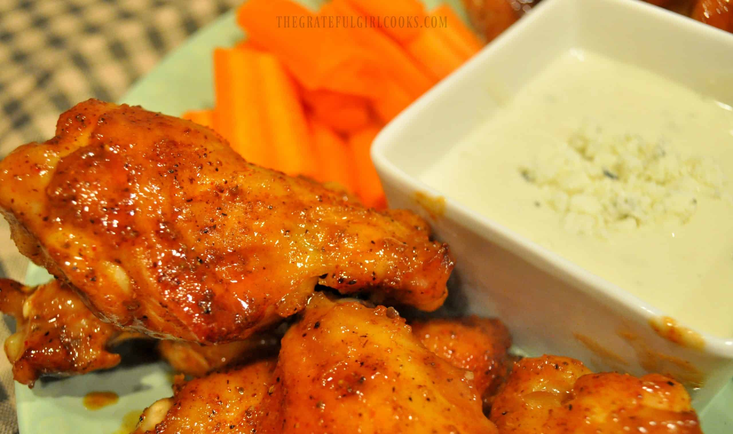 Carrots and dip are served with the cooked buffalo honey chicken wings.