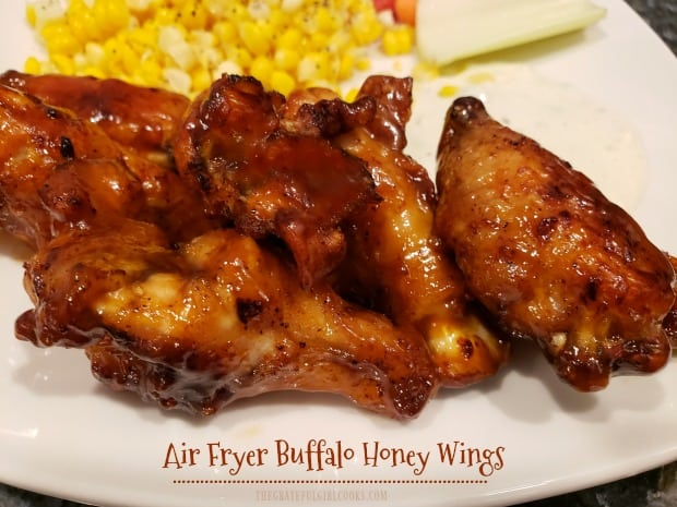 Delicious Air Fryer Buffalo Honey Wings are seasoned with a spice rub, cooked until crisp, and coated with a sweet, spicy sauce to serve.