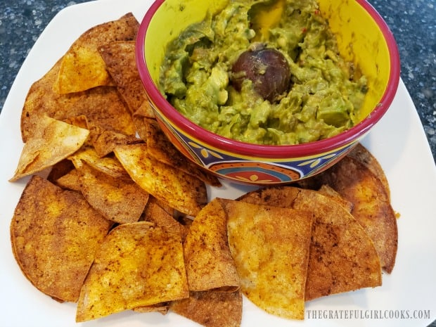 A plate of air fried chili-lime tortilla chips, served with guacamole.