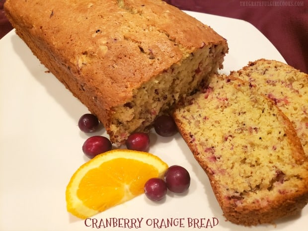 Make a large, delicious loaf of Cranberry Orange Bread! You'll love this EASY recipe which is perfect for snacking, holidays, or gift-giving!