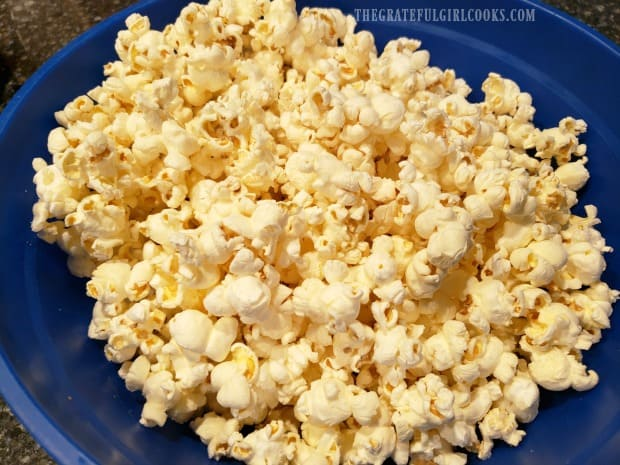 Plain popcorn is popped and ready to turn into caramel corn.