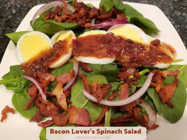 Enjoy Bacon Lover's Spinach Salad for two! Baby spinach leaves topped with hard-boiled eggs, red onion, crisp bacon, and warm bacon dressing!