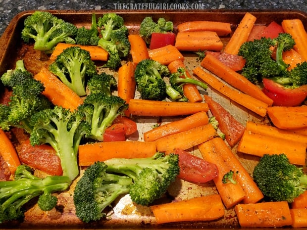 Seasoned vegetables are baked in an oven for ten minutes before turning.