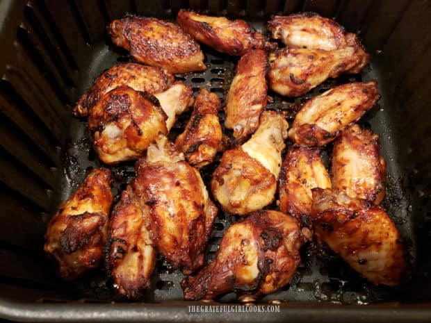When halfway done, Asian BBQ chicken wings are flipped over to finish cooking.
