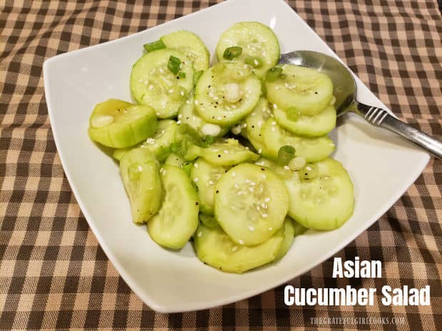 Asian Cucumber Salad is an easy side dish, with sliced cucumbers & green onions marinated in an Asian-inspired sauce, served cold and crispy!