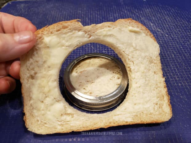 A hole has been made in the slice of sourdough bread.