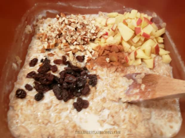 Maple syrup, raisins, nuts, apple and cinnamon are added to oatmeal.