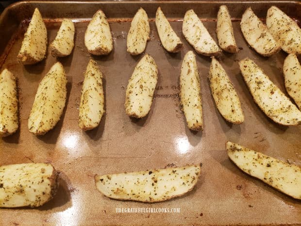 The Parmesan garlic potato wedges are baked in a single layer, skin side down.