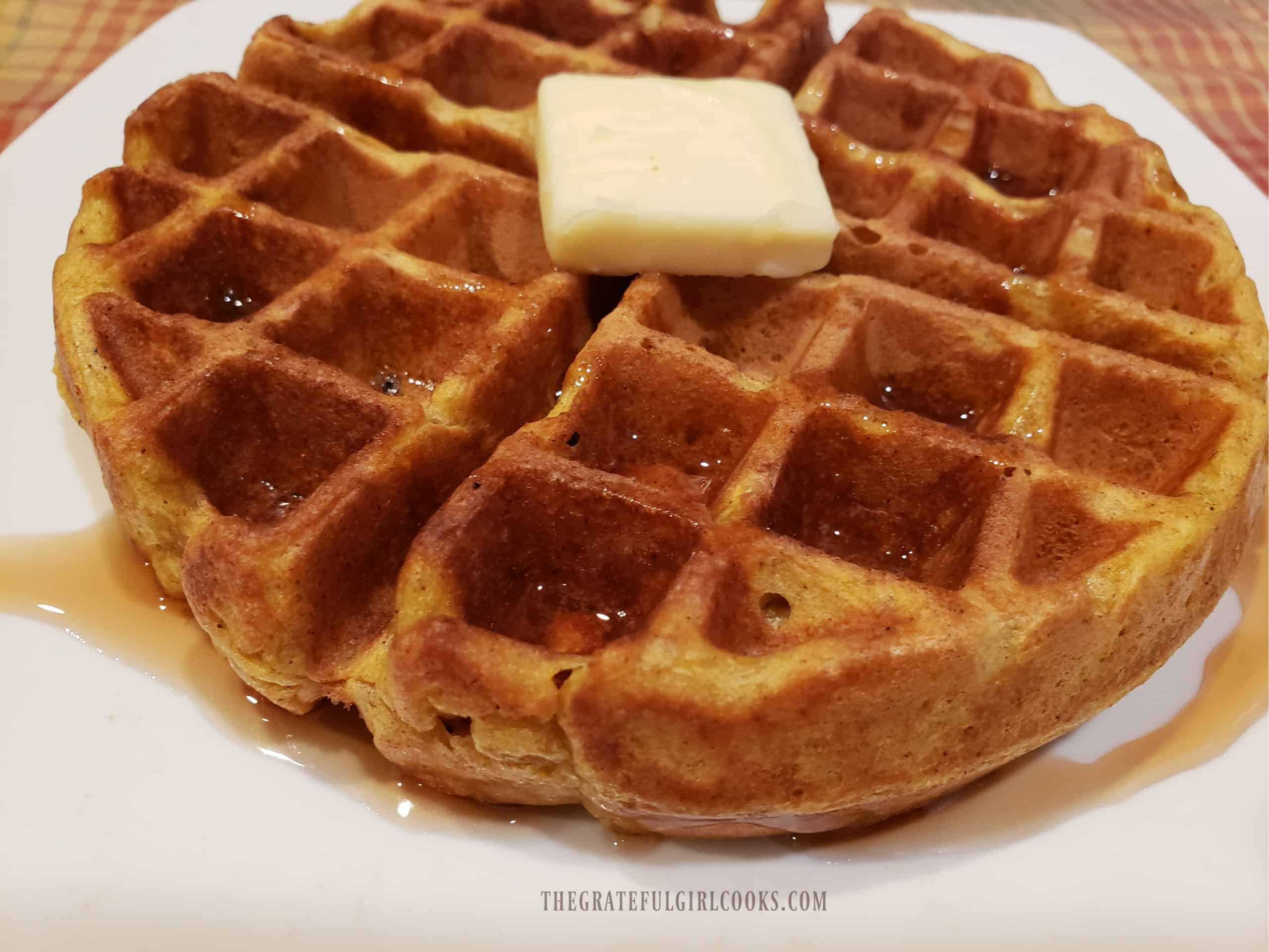 Butter and drizzled maple syrup top off the pumpkin spice waffles.