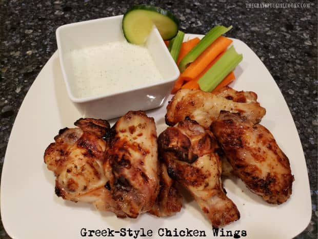 Greek-Style Chicken Wings can be baked or cooked in an air fryer! These marinated wings are served with homemade tzatziki sauce for dipping.