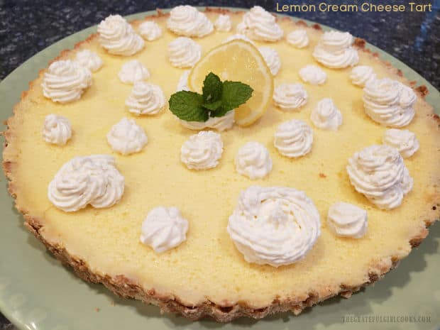 This Lemon Cream Cheese Tart is a bit tangy, a bit sweet, and tastes fantastic! A creamy lemon filling is baked on a shortbread-style crust.