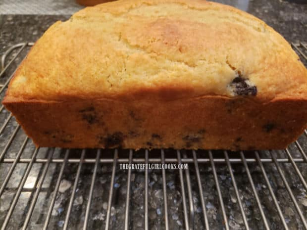 A side view of the blueberry breakfast loaf, out of the pan and on wire rack.