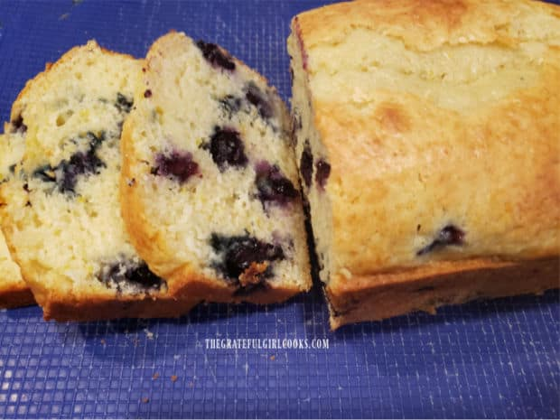 Slices of the blueberry breakfast loaf reveal the juicy blueberries inside.