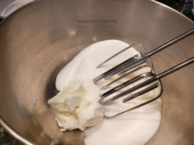 Granulated sugar and vegetable shortening are creamed together with an electric mixer.