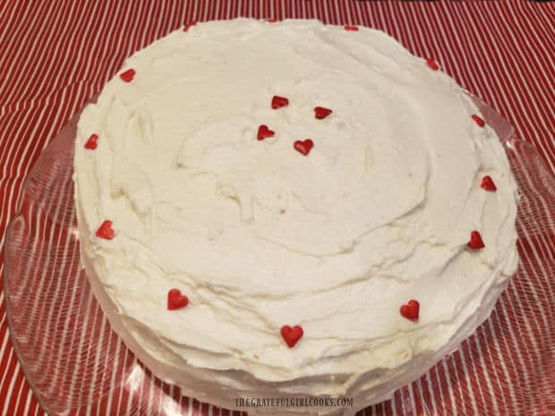 Grandma's red velvet cake is completely frosted and ready to slice and eat!